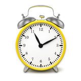 Yellow retro styled classic alarm clock isolated Stock Image