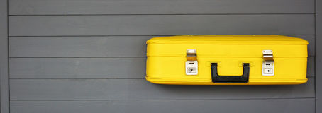 Yellow retro suitcases on the wooden grey background. Vintage travel luggage. Space for text. Flat lay. Concept: tourism, travel and migration Royalty Free Stock Photography
