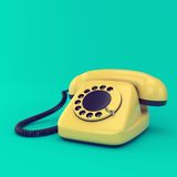 Yellow retro telephone Royalty Free Stock Photo