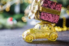 Yellow retro toy car. Delivering Christmas or New Year gifts on dark background royalty free stock photos