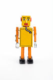 Yellow retro toy robot. Royalty Free Stock Photos