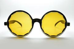 Yellow retro / vintage glasses / eye wear, black frame. Fashion acessories royalty free stock photography
