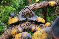 Yellow rhino beetle statue Stock Images