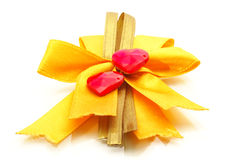Yellow ribbon bow and heart Royalty Free Stock Photography