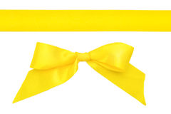 Yellow ribbon with a bow isolated on white Royalty Free Stock Image