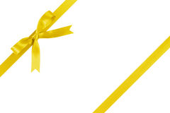 Yellow ribbon with bow for packaging with tails Stock Image