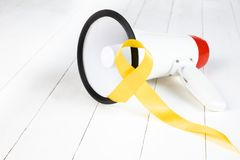 Yellow ribbon symbolic color for Sarcoma Bone cancer awareness and suicide prevention. Yellow ribbon symboliolor for Sarcoma Bone cancer awareness and suicide stock photo
