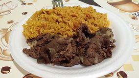 Yellow rice and Beef. Lunch royalty free stock photo