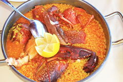 Yellow rice with lobster Stock Photography