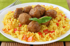 Yellow rice with meatballs Royalty Free Stock Images