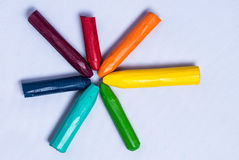 Yellow right starburst of colors. Colorful crayons bursting out like a star Royalty Free Stock Photography