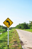 A yellow right turn road sign Royalty Free Stock Photos