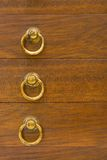 Yellow rings on wooden boxes Stock Photos
