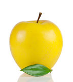 Yellow ripe apple with green leaf Royalty Free Stock Photo