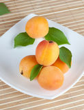 Yellow ripe apricot with green leaves Royalty Free Stock Photo