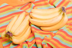 Yellow ripe bananas on colorful napkin Royalty Free Stock Image