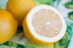 Yellow ripe lemons. Three ripe yellow lemon on the table Stock Photos