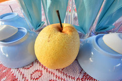 Yellow ripe pear on the table Royalty Free Stock Image