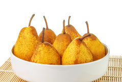 Yellow ripe pears in a white bowl Stock Images
