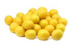 Yellow ripe plum fruit. On white background Royalty Free Stock Images