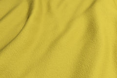 Yellow rippled fabric Royalty Free Stock Photo