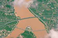 Yellow river and bridge stock photo