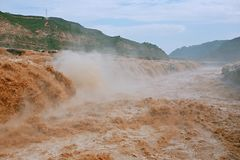Hukou Falls of Yellow River. The Yellow River Hukou Waterfall, known as the & x22;the Yellow River wonder& x22;, is the only yellow waterfall in the Yellow River Stock Images