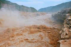 Hukou Falls of Yellow River. The Yellow River Hukou Waterfall, known as the & x22;the Yellow River wonder& x22;, is the only yellow waterfall in the Yellow River Royalty Free Stock Photo
