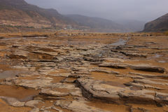 The Yellow River, Shanxi Province, China`s famous tourist attractions near the riverbed in Hukou Waterfall Royalty Free Stock Photography