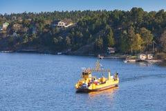 Yellow Ro-Ro cargo ship crossing the bay Stock Image