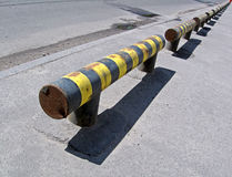 Yellow road barier, hazard warning,. Yellow road barier, hazard warning near asphalt road royalty free stock photo