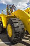 Yellow road building powerful wheeler Royalty Free Stock Images
