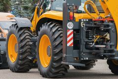 Yellow road constructor tractor - industrial equipment. Horizontal stock photo