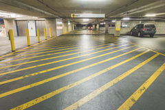 Yellow road crossing line in Parking Garage interior in the mall.  Royalty Free Stock Images