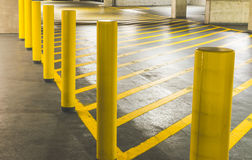 Yellow road crossing pole in Parking Garage interior in the mall Stock Photography