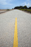 Yellow road divider Royalty Free Stock Photography