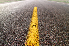 Yellow road dividing line Royalty Free Stock Image
