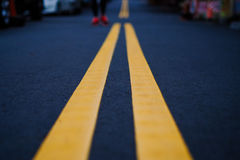 The yellow road line on black street stock images