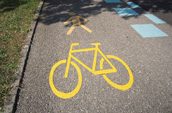 Yellow road marking indicating an bicycle path and pedestrian walkway. Swiss yellow road marking in Thun indicating the road is a pedestrian walkway and bicycle Royalty Free Stock Photos
