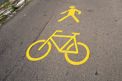 Yellow road marking indicating an bicycle path and pedestrian walkway. Swiss yellow road marking in Thun indicating the road is a pedestrian walkway and bicycle Stock Images
