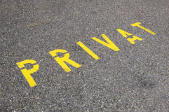 Yellow road marking indicating a private parking spot or entrance. A Swiss yellow road marking in Lauterbrunnen is indicating traffic that this is a private Royalty Free Stock Photo