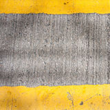 Yellow road marking lines pictured from above Royalty Free Stock Images