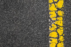 Yellow Road Marking Stripe On Asphalt Background Stock Photos