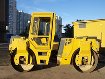 Yellow road roller Stock Image