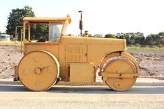 Yellow road roller machine Royalty Free Stock Image