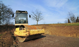 Yellow road roller at site Stock Photo