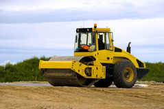 Yellow road roller at work Royalty Free Stock Image