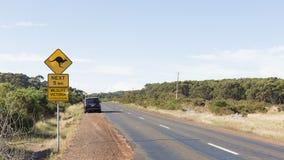 Yellow road sign with a kangaroo, Australia Royalty Free Stock Photos