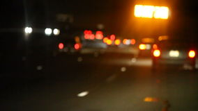 Yellow road sign at night stock footage