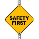 Yellow road sign of safety first Stock Photos